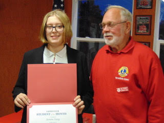 Photo of Jasmine Young with Lions Club member Dr. Bill Decker.